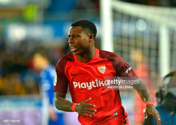 Sevilla's Dutch midfielder Quincy Promes gestures during the Spanish league football match Deportivo Alaves against Sevilla FC at the Mendizorroza...
