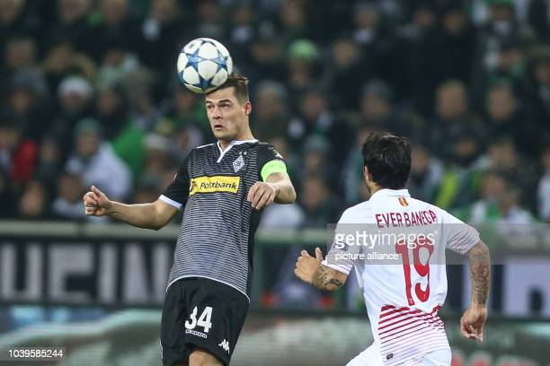 Sevilla's Ever Banega and Moenchengladbach's Granit Xhaka vie for the ball during the Champions League soccer match between Borussia Moenchengladbach...