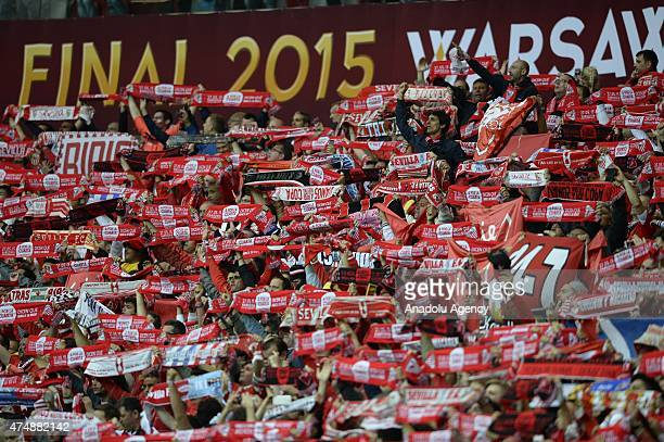Sevilla's fans cheer up during the UEFA Europa League Final match between FC Dnipro Dnipropetrovsk and FC Sevilla on May 27 2015 in Warsaw Poland
