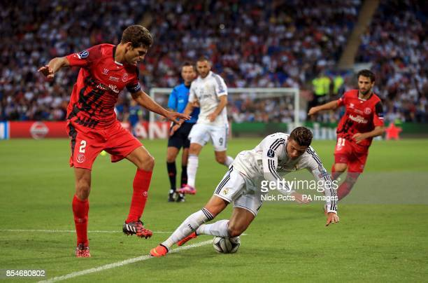 Sevilla's Federico Fazio and Real Madrid's Cristiano Ronaldo battle for the ball during the UEFA Super Cup Final at the Cardiff City Stadium Cardiff