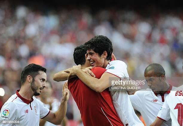 Sevilla's forward Carlos Fernandez celebrates a goal with teammates during the Spanish league football match Sevilla FC vs UD Las Palmas at the Ramon...