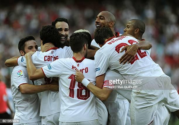 Sevilla's forward Carlos Fernandez celebrates with teammates after scoring during the Spanish league football match Sevilla FC vs UD Las Palmas at...