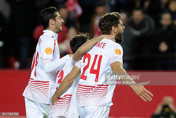Sevilla's forward Fernando Llorente celebrates his second goal during the UEFA Europa League Round of 32 first leg football match Sevilla FC vs Molde...