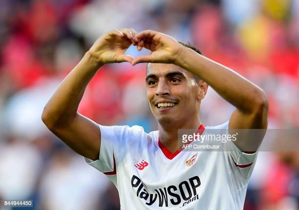 Sevilla's forward from France Wissam Ben Yedder celebrates after scoring a goal during the Spanish Liga football match Sevilla FC vs SD Eibar at the...