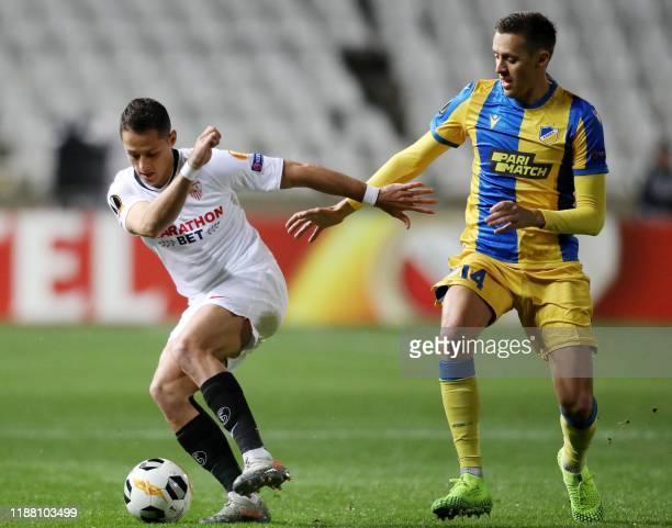 Sevilla's forward Javier Hernandez is marked by APOEL's midfielder Uros Matic during the UEFA Europa league Group A football match between APOEL...