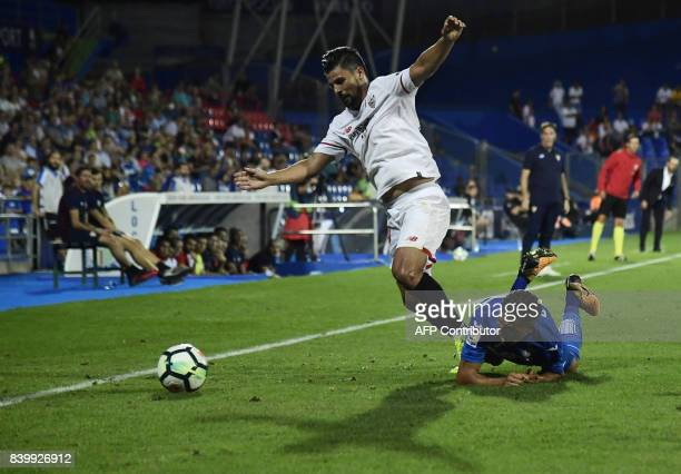 Sevilla's forward Nolito vies with Getafe's Moroccan forward Faycal Fajr during the Spanish league football match Getafe CF vs Sevilla FC at the...