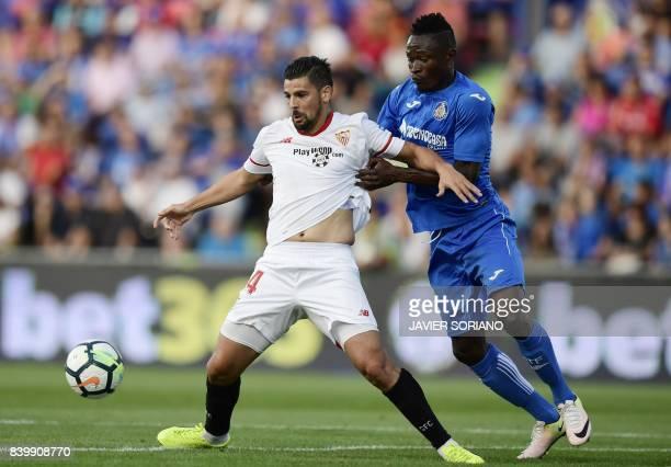 Sevilla's forward Nolito vies with Getafe's Togolese defender Djene Ortega during the Spanish league football match Getafe CF vs Sevilla FC at the...
