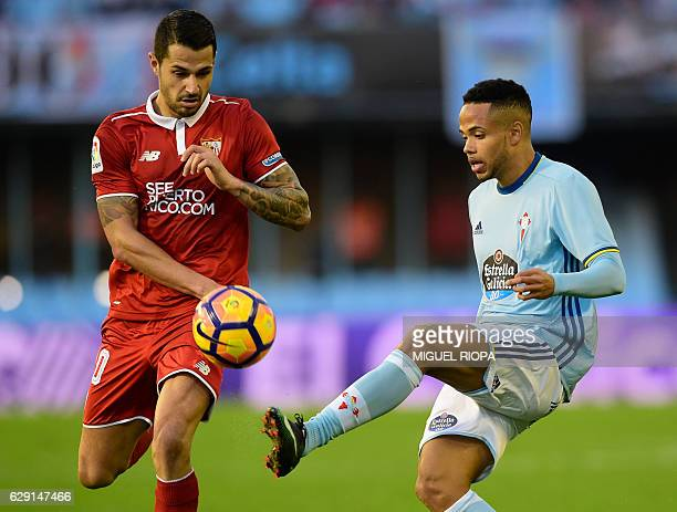 Sevilla's forward Vitolo vies with Celta Vigo's Belgian forward Theo Bongonda during the Spanish league football match RC Celta de Vigo vs Sevilla FC...