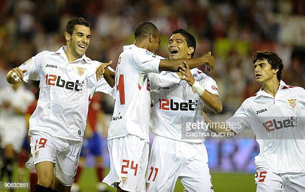 Sevilla's French defender Abdoulay Konko celebrates after scoring with teammates midfielder Renato midfielder Alvaro Negredo and midfielder Diego...