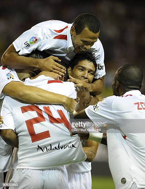 Sevilla's French defender Abdoulay Konko celebrates after scoring with Sevilla's Brazilian midfielder Renato Sevilla's midfielder Álvaro Negredo and...