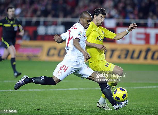 Sevilla's French defender Abdoulay Konko vies with Villarreal's Argentinian defender Mateo Musacchio during a Spanish King's Cup football match at...