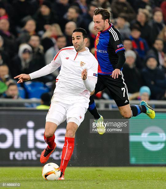 Sevilla's French defender Adil Rami and Basel's Swiss midfielder Luca Zuffi vies during the UEFA Europa League round of 16 first leg football match...