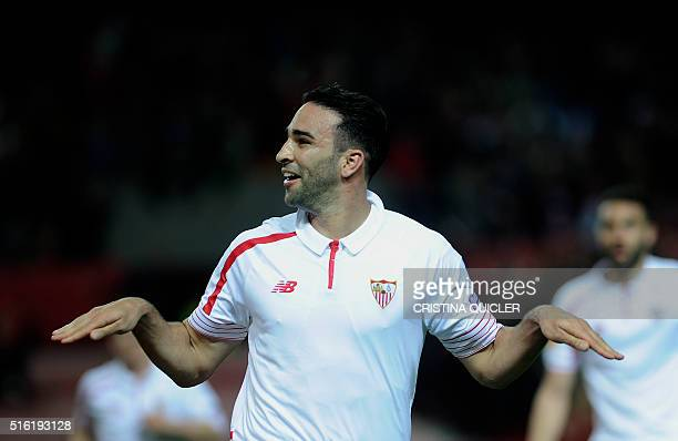 Sevilla's French defender Adil Rami celebrates after scoring a goal during the UEFA Europa League round of 16 second leg football match between...