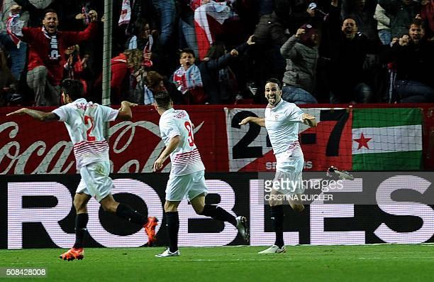 Sevilla's French defender Adil Rami celebrates after scoring during the Spanish Copa del Rey semifinal first leg football match Sevilla FC vs RC...
