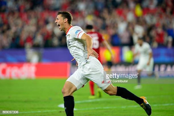 Sevilla's French defender Clement Lenglet celebrates after scoring a goal during the UEFA Champions League group E football match between Sevilla and...