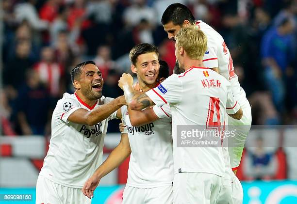 Sevilla's French defender Clement Lenglet celebrates with teammates after scoring a goal during the UEFA Champions League group E football match...