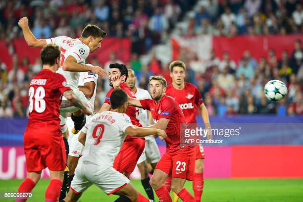 Sevilla's French defender Clement Lenglet scores a header during the UEFA Champions League group E football match between Sevilla and Spartak Moscow...