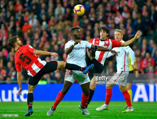 Sevilla's French defender Joris Gnagnon vies with Athletic Bilbao's Spanish defender Yeray Alvarez and Spanish defender Mikel San Jose during the...