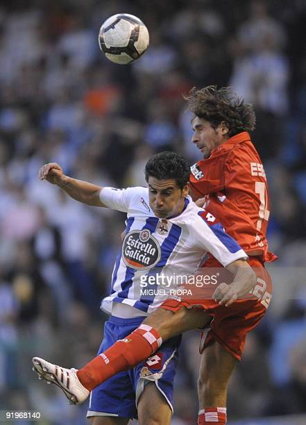 Sevilla's French defender Julien Escude vies with Deportivo Coruna's forward Riki during their Spanish league football match at Riazor Stadium in...