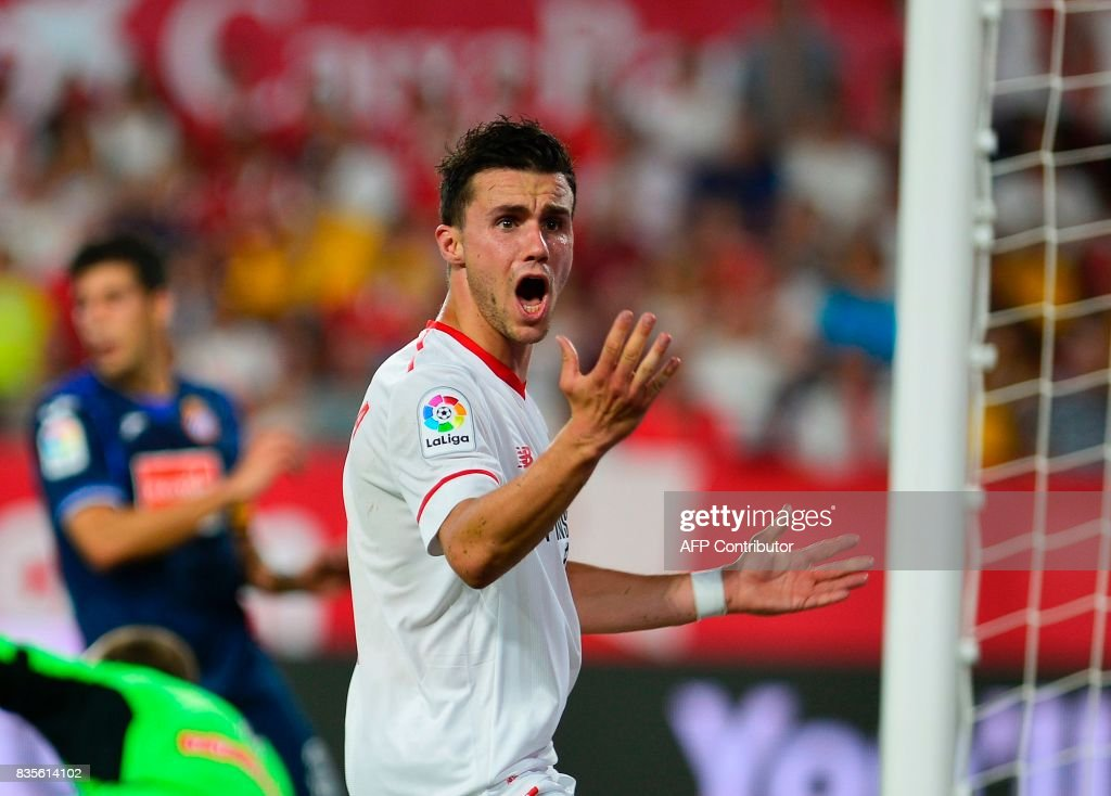 Sevilla's French defender Sebastien Corchia (C) reacts to a decision of the referee during the Spanish league football match Sevilla FC vs Espanyol at the Ramon Sanchez-Pizjuan in Sevilla on August 19, 2017. QUICLER