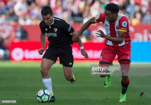 Sevilla's French defender Sebastien Corchia vies with Girona's Colombian defender Johan Mojica during the Spanish league football match Girona FC vs...
