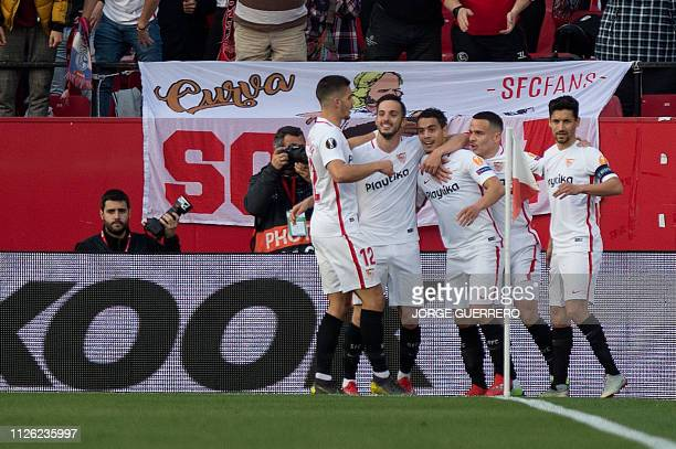 Sevilla's French forward Ben Yedder celebrates with his teammates after scoring during the UEFA Europa League round of 32 second leg football match...