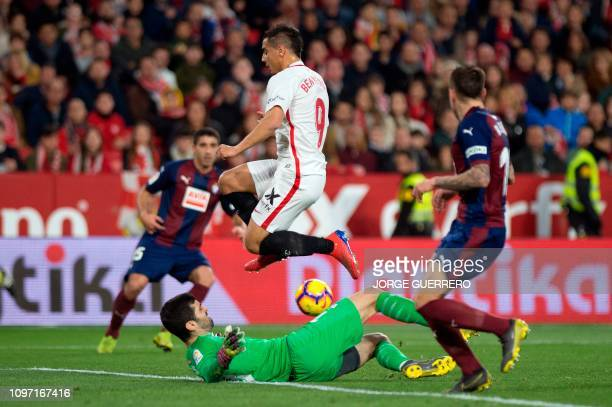 Sevilla's French forward Ben Yedder fights for the ball with Eibar's Spanish goalkeeper Asier Riesgo during the Spanish league football match Sevilla...