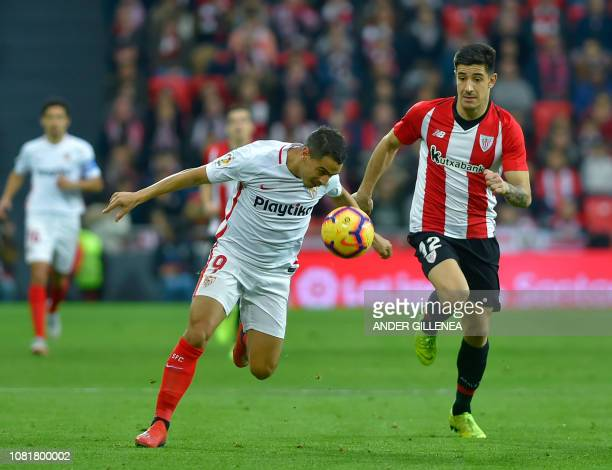 Sevilla's French forward Ben Yedder vies with Athletic Bilbao's Spanish defender Yuri Berchiche during the Spanish League football match between...