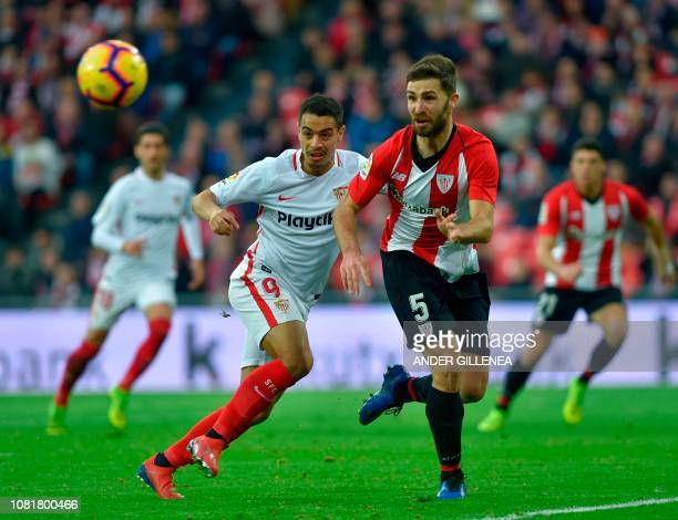 Sevilla's French forward Ben Yedder vies with Athletic Bilbao's Spanish defender Yeray Alvarez during the Spanish League football match between...