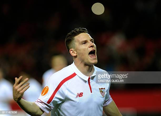 Sevilla's French forward Kevin Gameiro celebrates a goal during the UEFA Europa League Round of 32 first leg football match Sevilla FC vs Molde FK at...