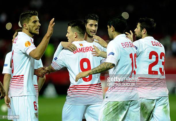 Sevilla's French forward Kevin Gameiro celebrates a goal with teammates during the UEFA Europa League Round of 32 first leg football match Sevilla FC...