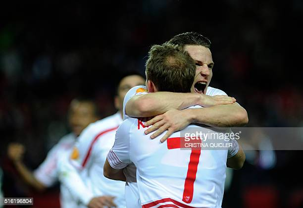 Sevilla's French forward Kevin Gameiro celebrates after scoring a goal during the UEFA Europa League round of 16 second leg football match between...