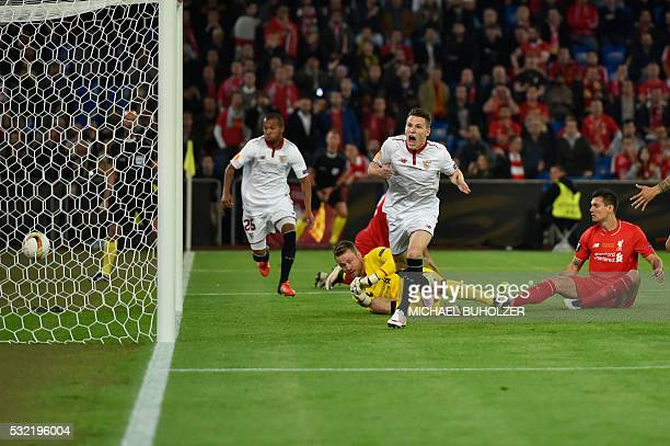 Sevilla's French forward Kevin Gameiro celebrates after scoring a goal during the UEFA Europa League final football match between Liverpool FC and...