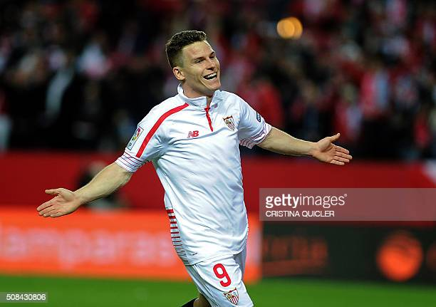 Sevilla's French forward Kevin Gameiro celebrates after scoring his second goal during the Spanish Copa del Rey semifinal first leg football match...