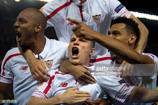 TOPSHOT Sevilla's French forward Kevin Gameiro celebrates with his teammates their victory at the end of the UEFA Europa League quarter finals second...