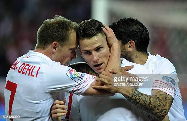 Sevilla's French forward Kevin Gameiro celebrates with Sevilla's Danish midfielder Michael KrohnDehli after scoring during the Spanish Copa del Rey...