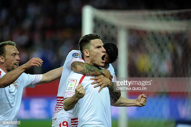 Sevilla's French forward Kevin Gameiro celebrates with teammates after scoring during the Spanish Copa del Rey semifinal first leg football match...