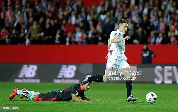 Sevilla's French forward Kevin Gameiro runs with the ball to score during the Spanish Copa del Rey semifinal first leg football match Sevilla FC vs...