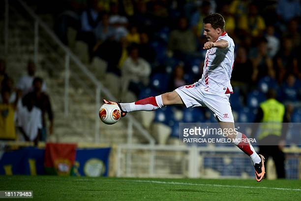 Sevilla's French forward Kevin Gameiro scores during the UEFA Europa League group H football match Estoril vs Sevilla at the Antonio Coimbra da Mota...