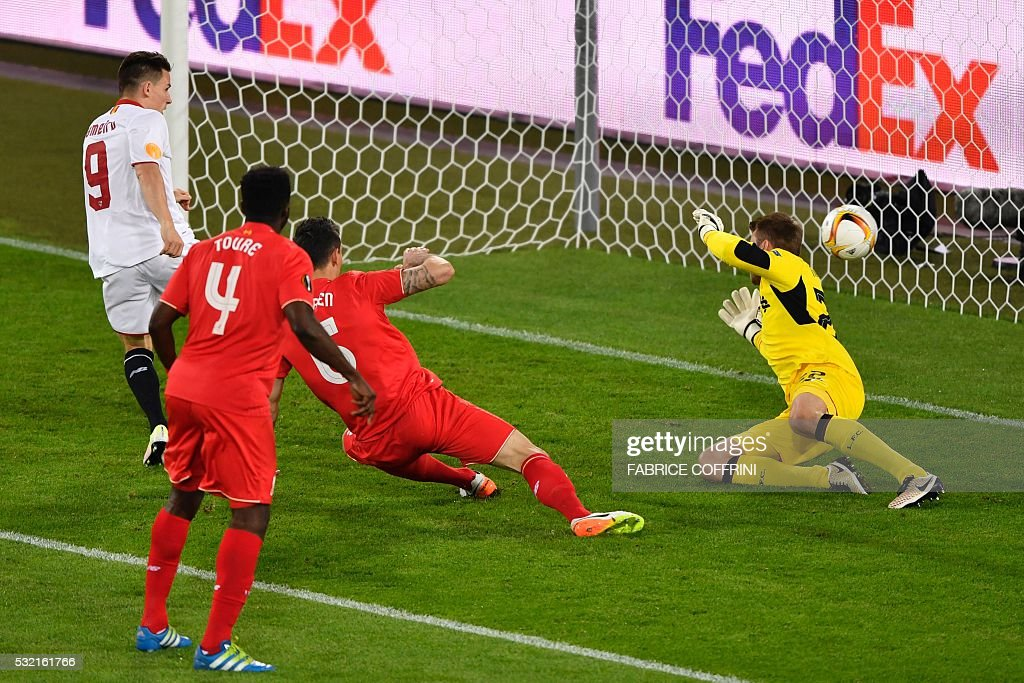 Sevilla's French forward Kevin Gameiro (L) shoots and scores his team's first goal during the UEFA Europa League final football match between Liverpool FC and Sevilla FC at the St Jakob-Park stadium in Basel, on May 18, 2016.