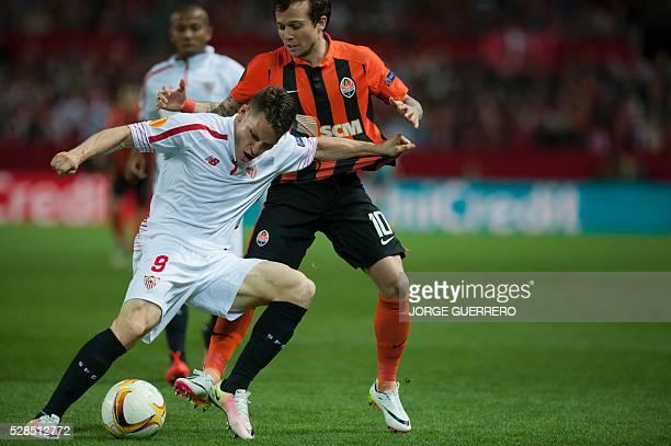 Sevilla's French forward Kevin Gameiro vies with Shakhtar Donetsk's Brazilian midfielder Bernard during the UEFA Europa League semifinal second leg...
