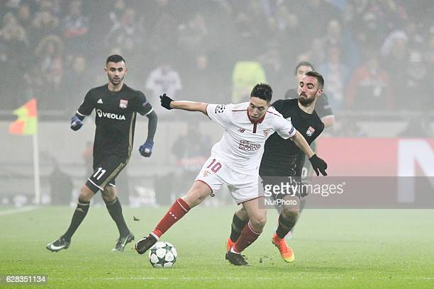 Sevilla's French forward Samir Nasri vies with Lyon's players Sergi Darder and Rachid Ghezzal during the UEFA Champions League Group H football match...