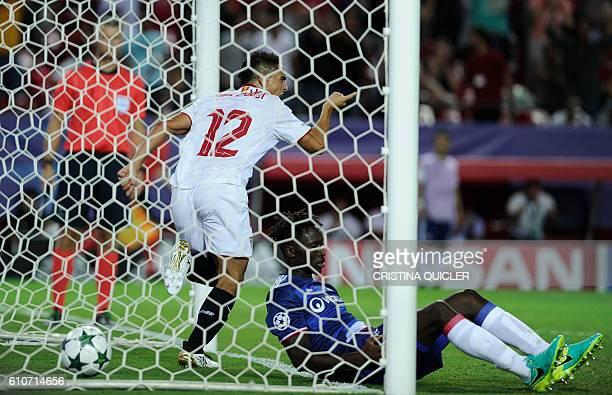 Sevilla's French forward Wissam Ben Yedder celebrates a goal beside Lyon's defender YangaMbiwa during the UEFA Champions League Group H football...