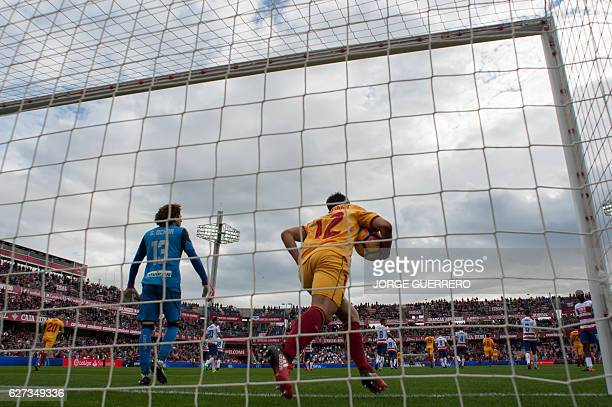 Sevilla's French forward Wissam Ben Yedder celebrates a goal during the Spanish league football match Granada CF vs Sevilla FC at Nuevo Los Carmenes...
