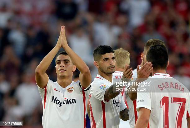 Sevilla's French forward Wissam Ben Yedder celebrates a goal with teammates during the Spanish league football match between Sevilla FC and RC Celta...