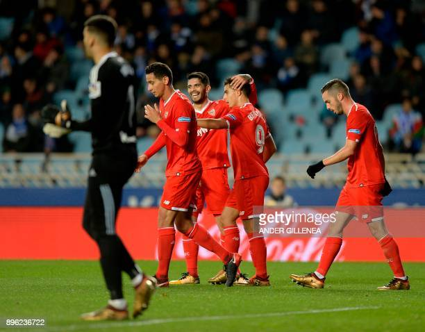 Sevilla's French forward Wissam Ben Yedder celebrates a goal with teamates during the Spanish league football match Real Sociedad vs Sevilla FC at...