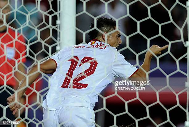 Sevilla's French forward Wissam Ben Yedder celebrates after scoring a goal during the UEFA Champions League Group H football match Sevilla FC vs...
