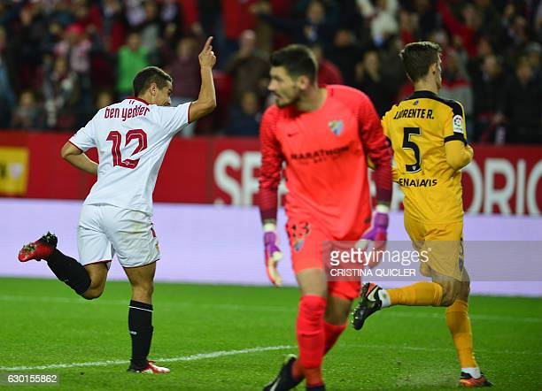 Sevilla's French forward Wissam Ben Yedder celebrates after scoring a goal during the Spanish league football match Sevilla FC vs Malaga CF at the...