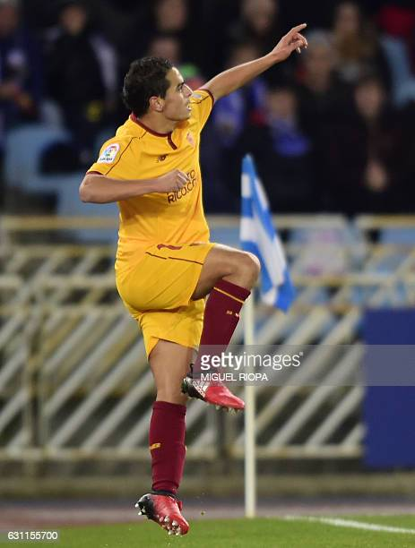 Sevilla's French forward Wissam Ben Yedder celebrates after scoring a goal during the Spanish league football match Real Sociedad vs Sevilla FC at...