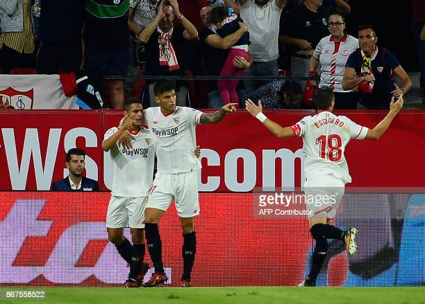 Sevilla's French forward Wissam Ben Yedder celebrates after scoring a goal during the Spanish league footbal match Sevilla FC vs Club Deportivo...